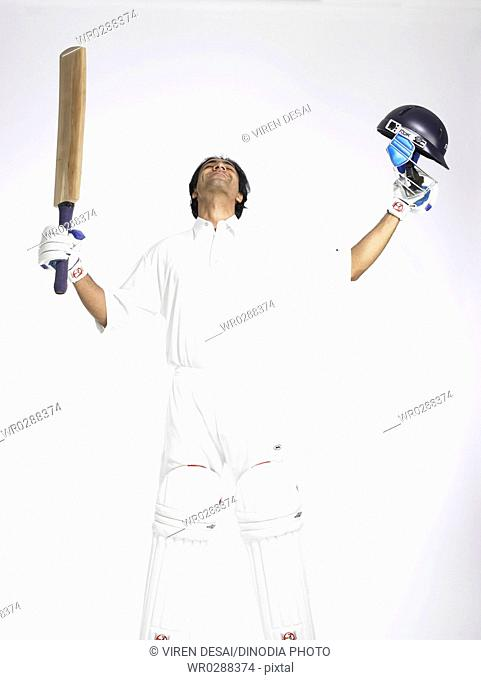 Indian batsman looking up in the sky to thank god for good score in cricket match MR702A