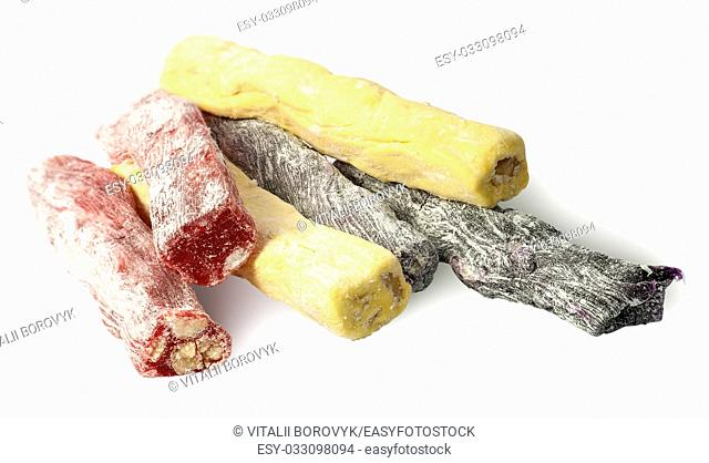 Several pieces of Turkish Delight in a row isolated on white background