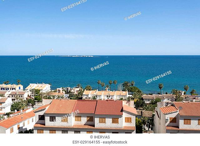 Views of Santa Pola town with Tabarca islet at the background. It is a coastal town located in the comarca of Baix Vinalopo, in the Valencian Community