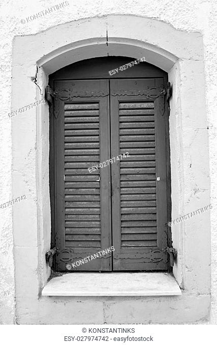 Window of an old building in Hersonissos, Crete, Greece. Black and white