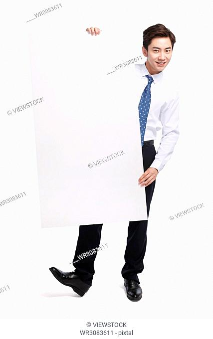 Business young man with a white board