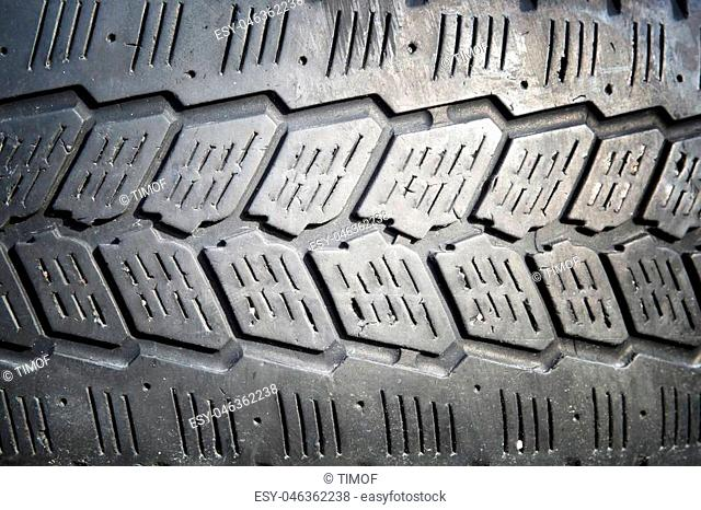 Erased automobile tires background. Structure of a tread of rubber
