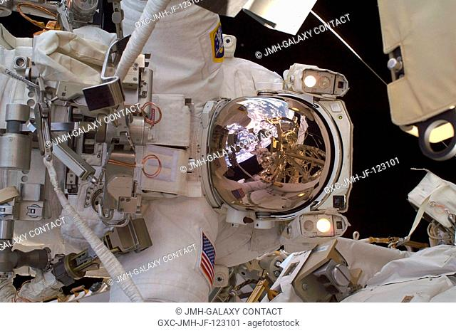 Astronaut Richard Arnold, STS-119 mission specialist, participates in the mission's third scheduled session of extravehicular activity (EVA) as construction and...