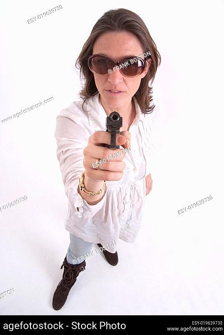 Aiming her gun at you
