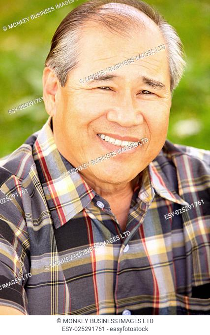 Portrait senior Asian man outdoors