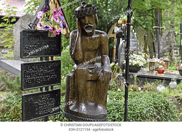 representation of ''Worried'' or ''Distressed'' Christ, related to the Polish folk culture, on wooden funerary stela in the old cemetery of Zakopane