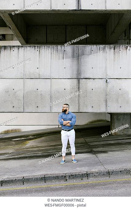 Bearded hipster businessman waiting