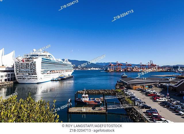 Cruise ship in dock at Vancouver taking on passengers and supplies for an Alaskan cruise