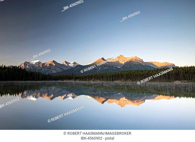 Herbert Lake at sunrise, reflection of the Bow Range, Banff National Park, Canadian Rocky Mountains, Alberta, Canada