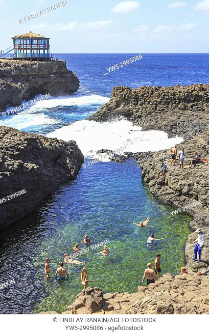 Naturally occurring swimming pool in the rocks at Baracona, on the west coast of Cape Verde near Terra Boa, Africa