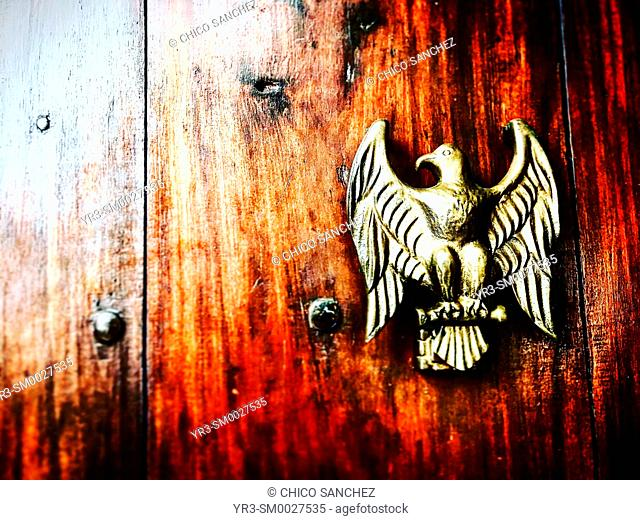 A golden eagle decorates a door in Coyoacan, Mexico City, Mexico