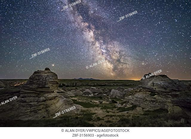 Mars (at left) and the galactic centre area of the summer Milky Way low over the southern horizon at Writing-on-Stone Provincial Park, Alberta, on June 8/9