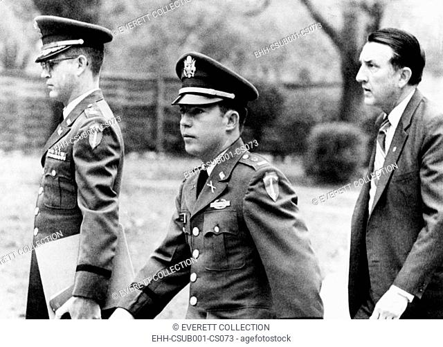 Army Lt. William Calley arriving at his court martial for leading the My Lai massacres. With him are Major Kenneth Raby (left) and Richard Kay of his defense...