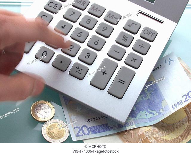 calculator and money - 01/01/2009