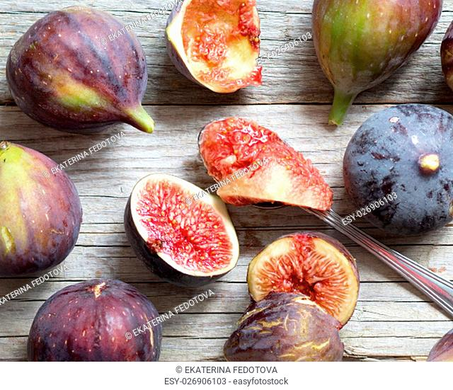 Fresh fruits - figs on the wooden table