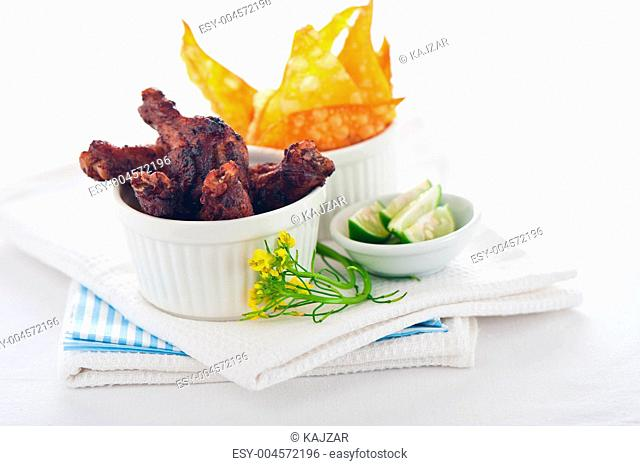 chicken legs with chips on a white background