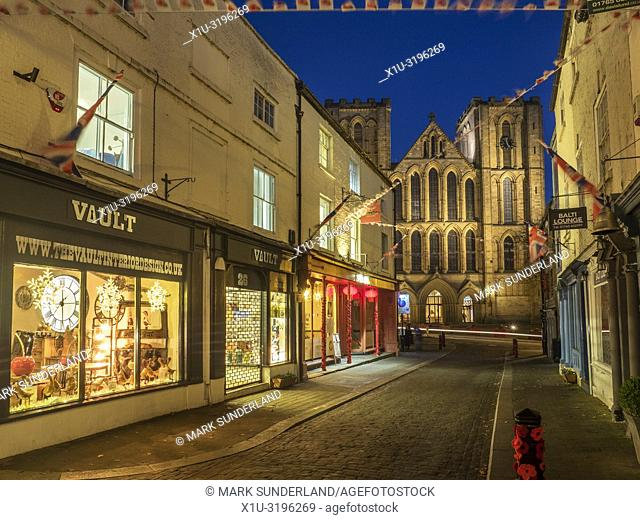 Ripon Cathedral floodlit at dusk from Kirkgate Ripon North Yorkshire England