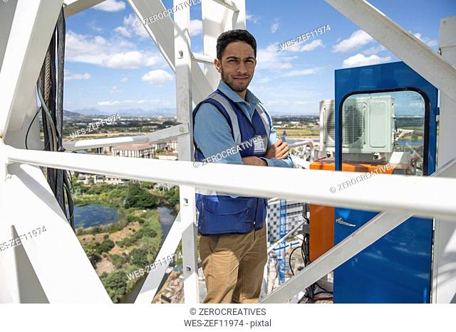Engineer standing on construction crane