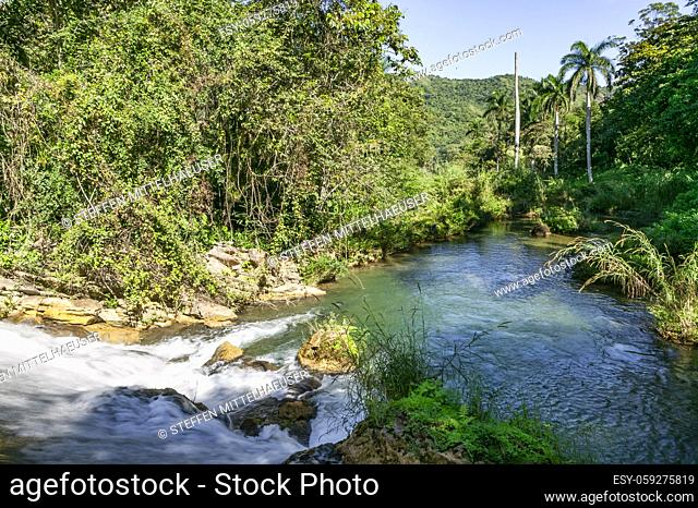 The rushing water of the El Nicho lower falls form a pristine natural swimming pool in El Nicho Nature Park, Cienfuegos province, Cuba