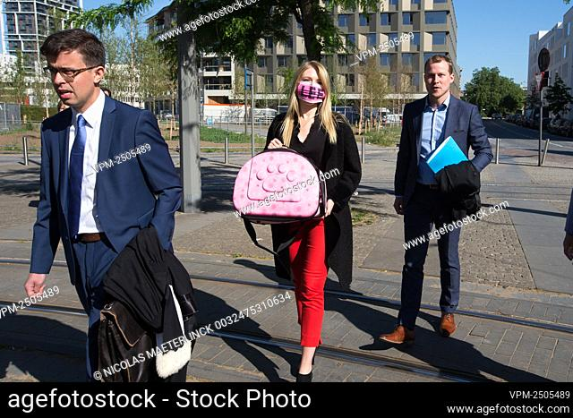 Selena Ali, wearing a mouth mask with the letters 'LEE', and carrying an empty cat travel bag arrives for a session of the Antwerp court of First Instance