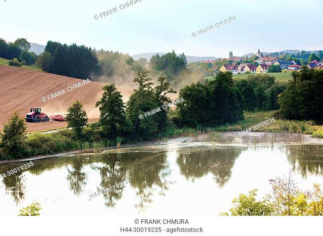 Tractor Plowing the Field in Southern Bohemia, Czech Republic