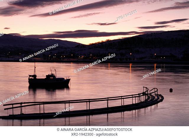 Sunrise in Kvaloyvagen, a fishing village near Tromso, in norwegian fjords