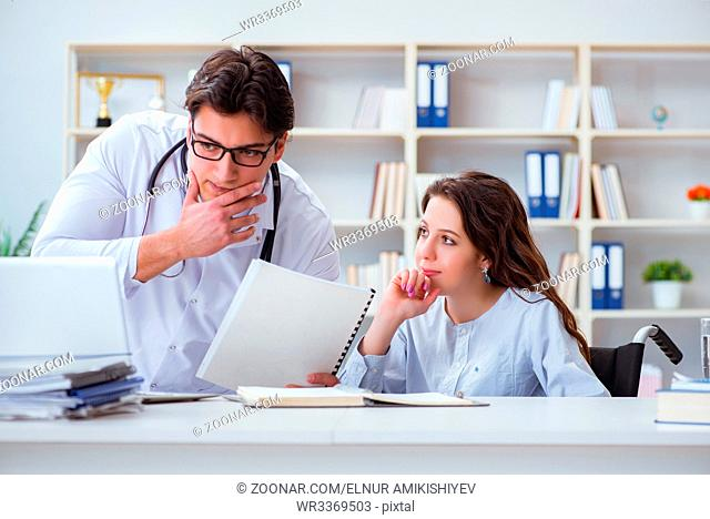 Female patient visiting male doctor for regular check-up in hospital clinic