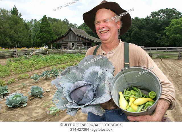 Landmark Park, Living History Farmstead c.1901, farmer, garden, cabbage, squash. Dothan, Wiregrass Region. Alabama. USA