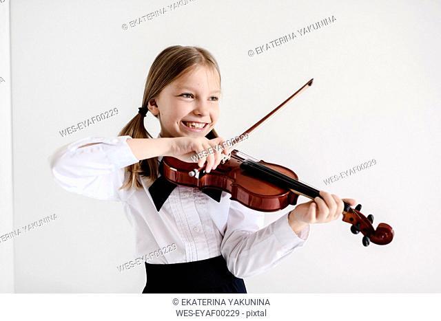 Happy girl playing violin