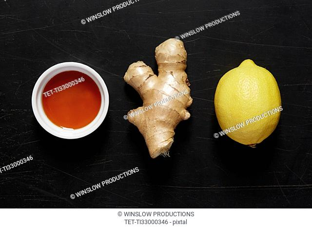 Bowl with honey, ginger and lemon