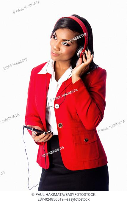 Beautiful happy business woman listening to podcast or music on wireless mobile phone, on white