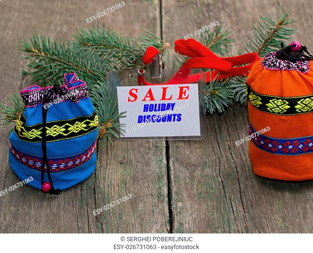 coniferous branch, blue and orange bag, label with an inscription Sale, the subject Christmas and New Year