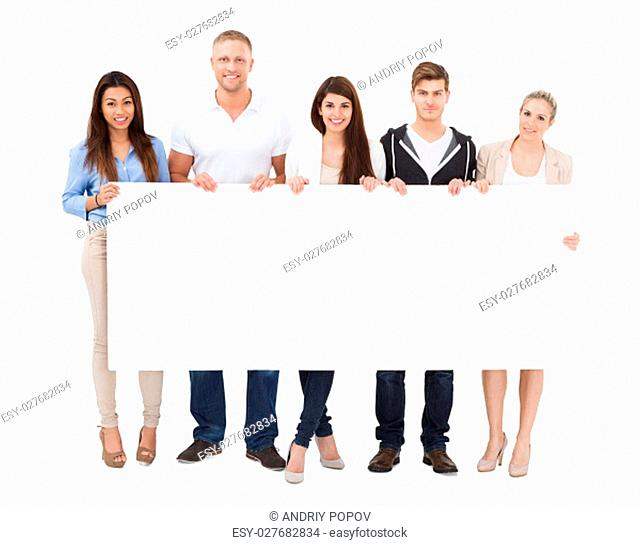 A Group Of Happy People With Different Multi Ethnicity Holding Billboard On White Background