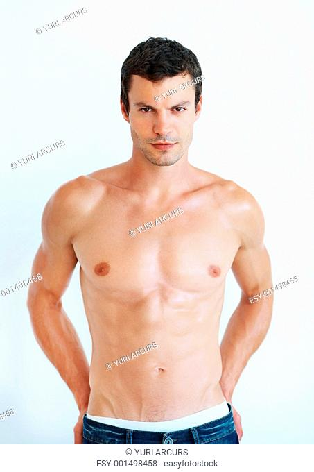 Portrait of sexy handsome man with muscular body