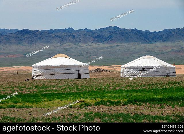 Traditional yurts between montains in Mongolia
