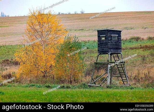 Wooden Hunters hunting tower in countryside landscape, Fall autumn season, Czech Republic, Highland, European Scenery