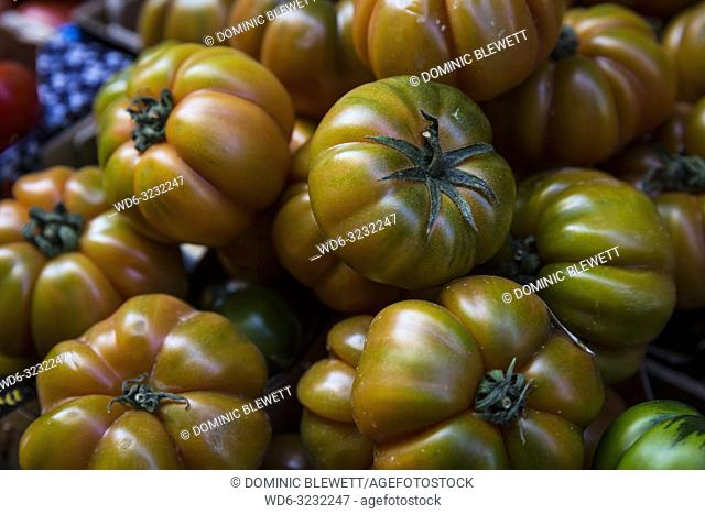 Fresh Beefsteak tomatoes for sale at a market stall in Bologna, Italy