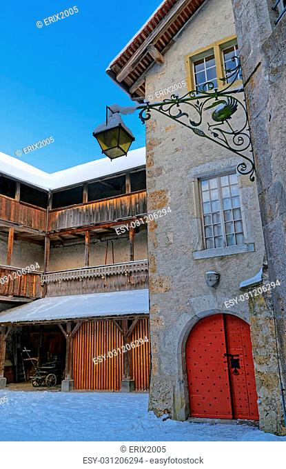 GRUYERE, SWITZERLAND - DECEMBER 31, 2014: Inner courtyard of the medieval castle of Gruyeres in Switzerland. It is a Swiss heritage site of national...