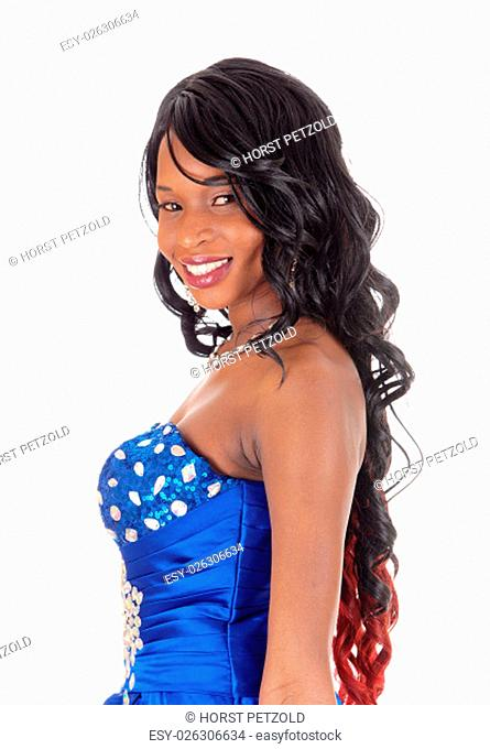 A profile portrait image of a happy African American woman in a blue.evening dress with long curly hair, isolated for white background.