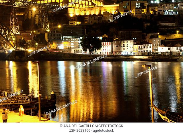 Dom Luis Bridge (Ponte Luis I) in the evening, Porto, Portugal. Douro river reflections