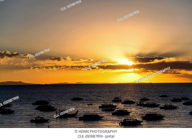 Golden sunset at Lake Titicaca viewed from Copacabana, Bolivia
