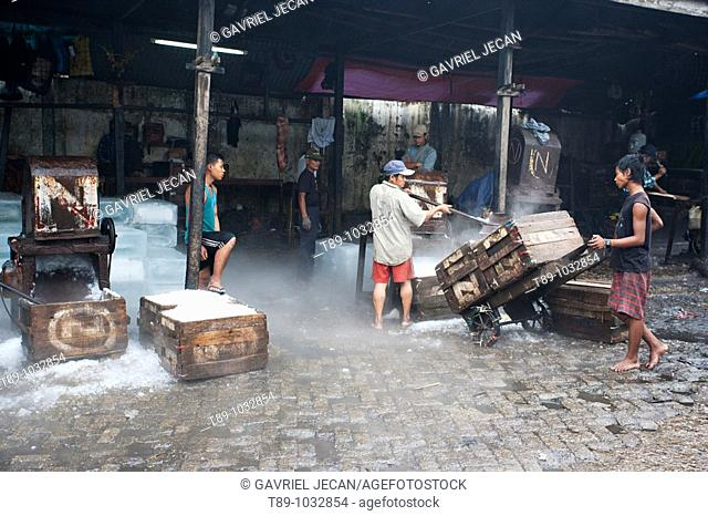 Man workers crashing Ice for the Fish Market in Yangon, Myanmar