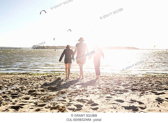 Mother with son and daughter on beach