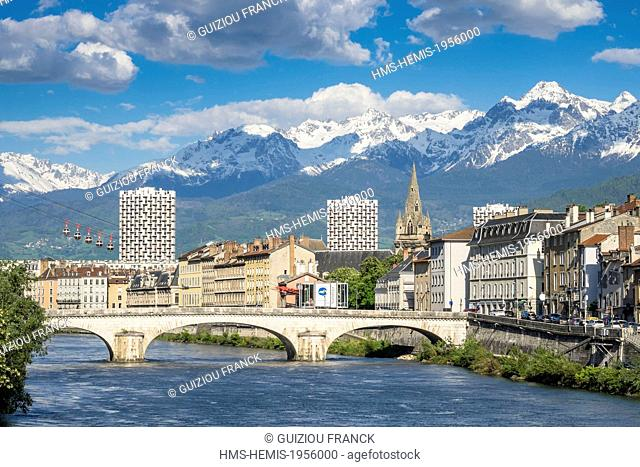 France, Isere, Grenoble, the banks of the Isere river, the 13th century Saint Andre church and Belledonne massif in the background