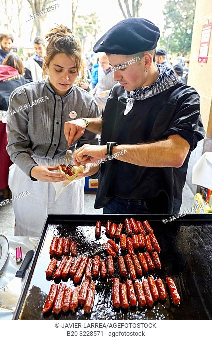 Frying txistorra (chorizo), People dressed in typical baserritarra clothes, Fair of Santo Tomas, Donostia, San Sebastian, Gipuzkoa, Basque Country, Spain