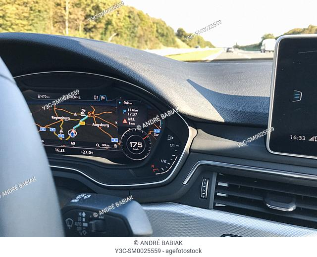 Modern car instrument cluster with speed, odometer, GPS map display, Germany