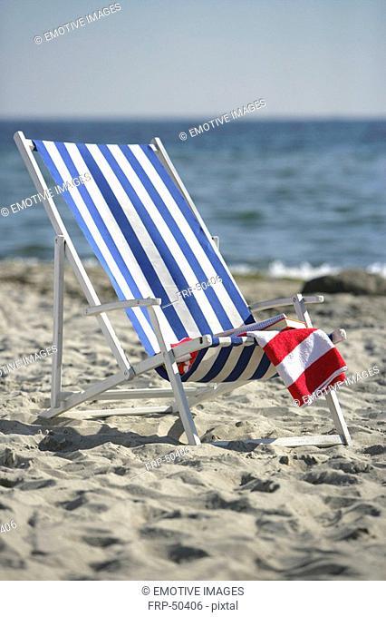 Blue and white deckchair on the beach