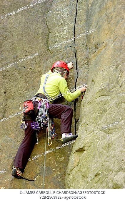 Rock climber Alicia Huddelson in New River Gorge National River West Virginia