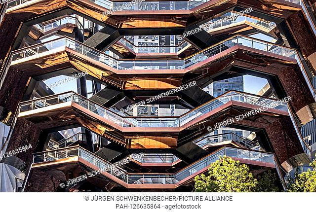 """""""""""""""""""""""The Vessel"""""""" is the name of the unusual structure in New York's new Hudson Yards district. Externally, the artwork resembles a vase"""