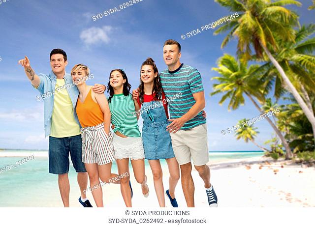 friends in sunglasses over exotic beach background